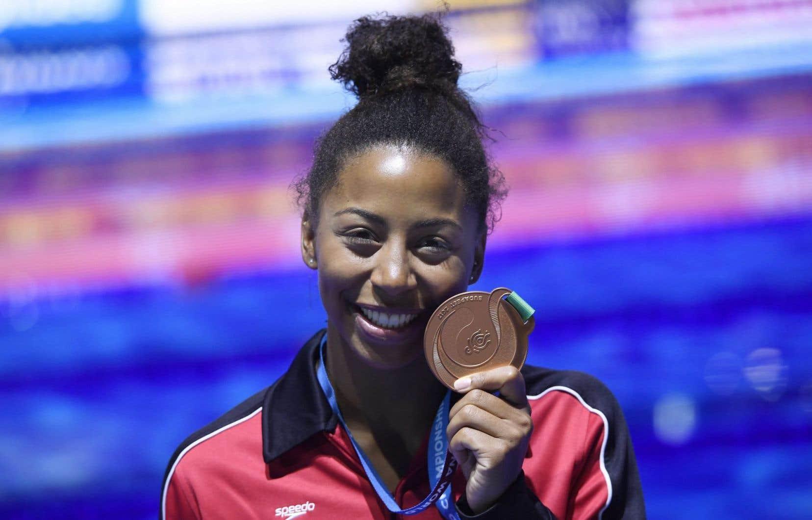 Jennifer Abel avait également gagné le bronze en 2011 au tremplin de trois mètres lorsqu'elle avait encore terminé derrière deux Chinoises.