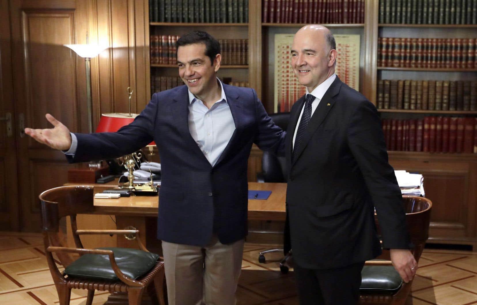 Alexis Tsipras, le premier ministre grec, et Pierre Moscovici, le commissaire européen aux Affaires économiques