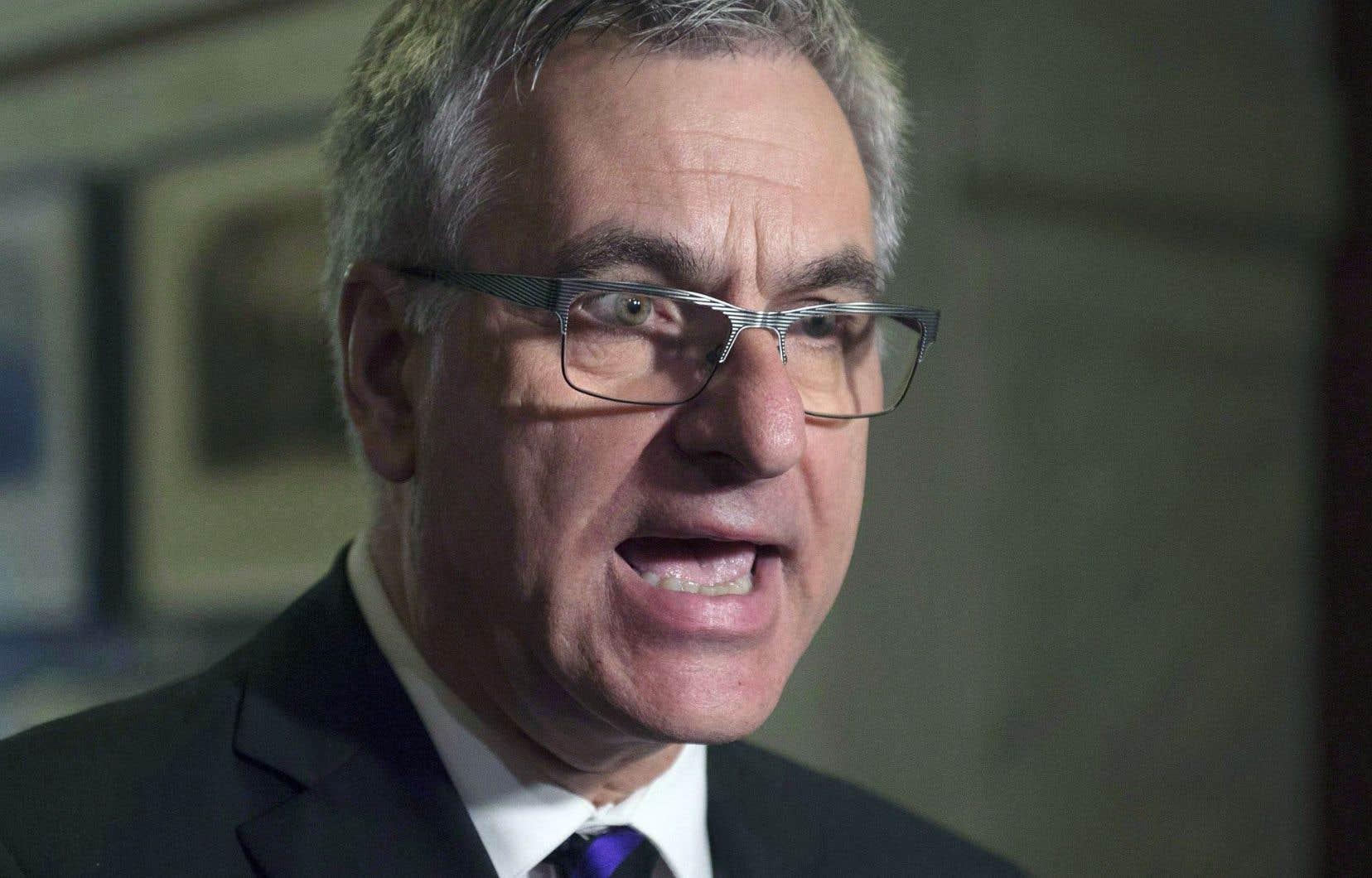Jean-Marc Fournier affirme qu'il n'a jamais été question d'aider un promoteur immobilier en échange de contributions à la caisse du parti.