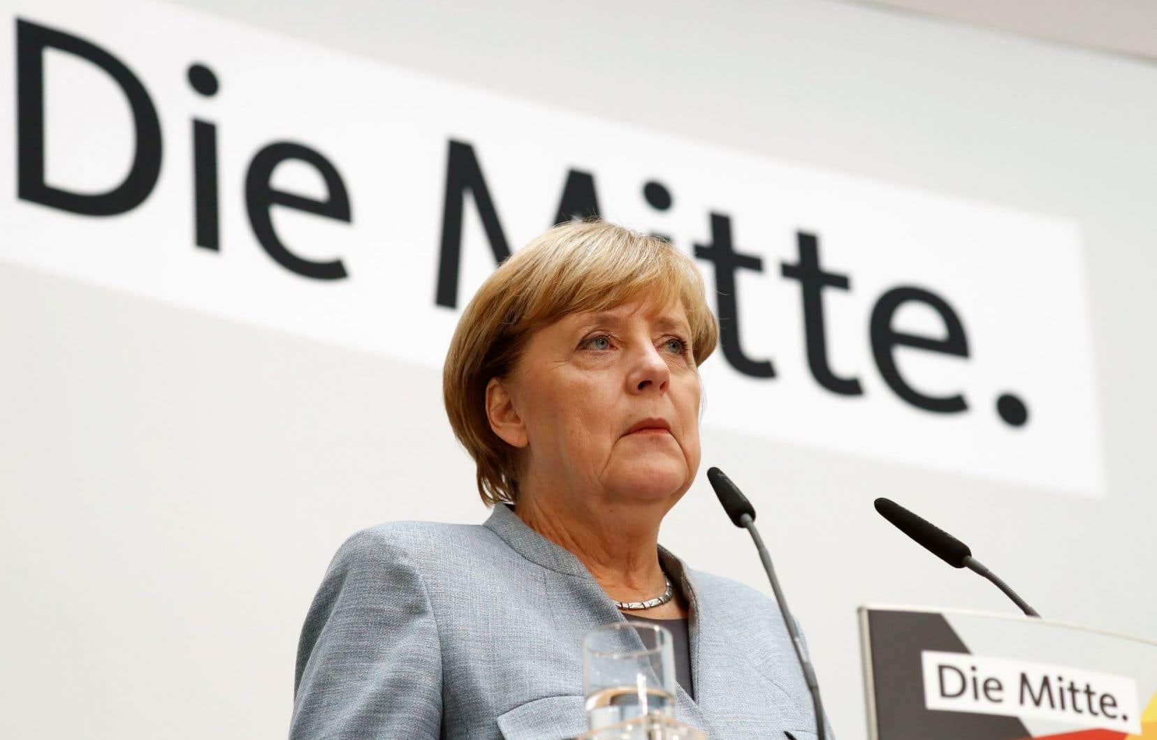 Angela Merkel a tenu une conférence de presse au lendemain de sa réélection, lundi, aux quartiers généraux de son parti.