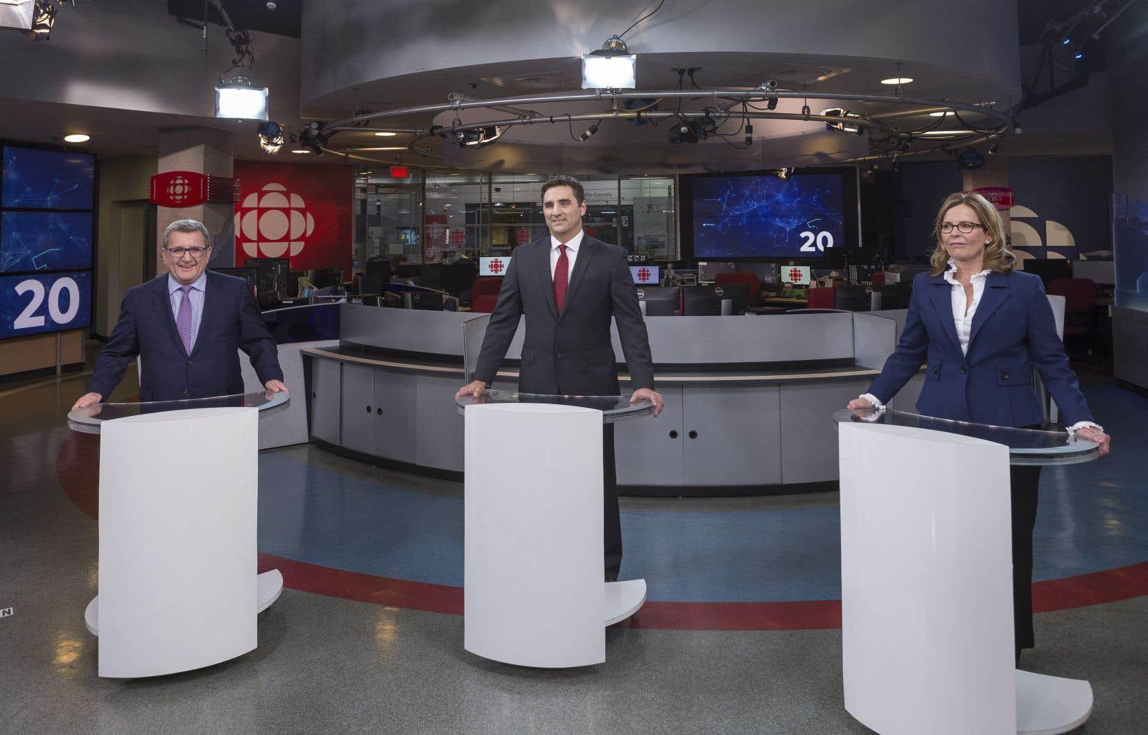 Les trois candidats lors du débat du 17 octobre, à Québec