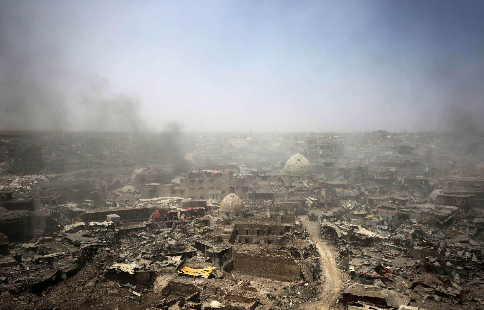 La ville de Mossoul, en Irak (ci-dessus le 9 juillet), a été libérée des djihadistes en juin dernier après avoir été sous le feu d'une violente offensive de neuf mois.