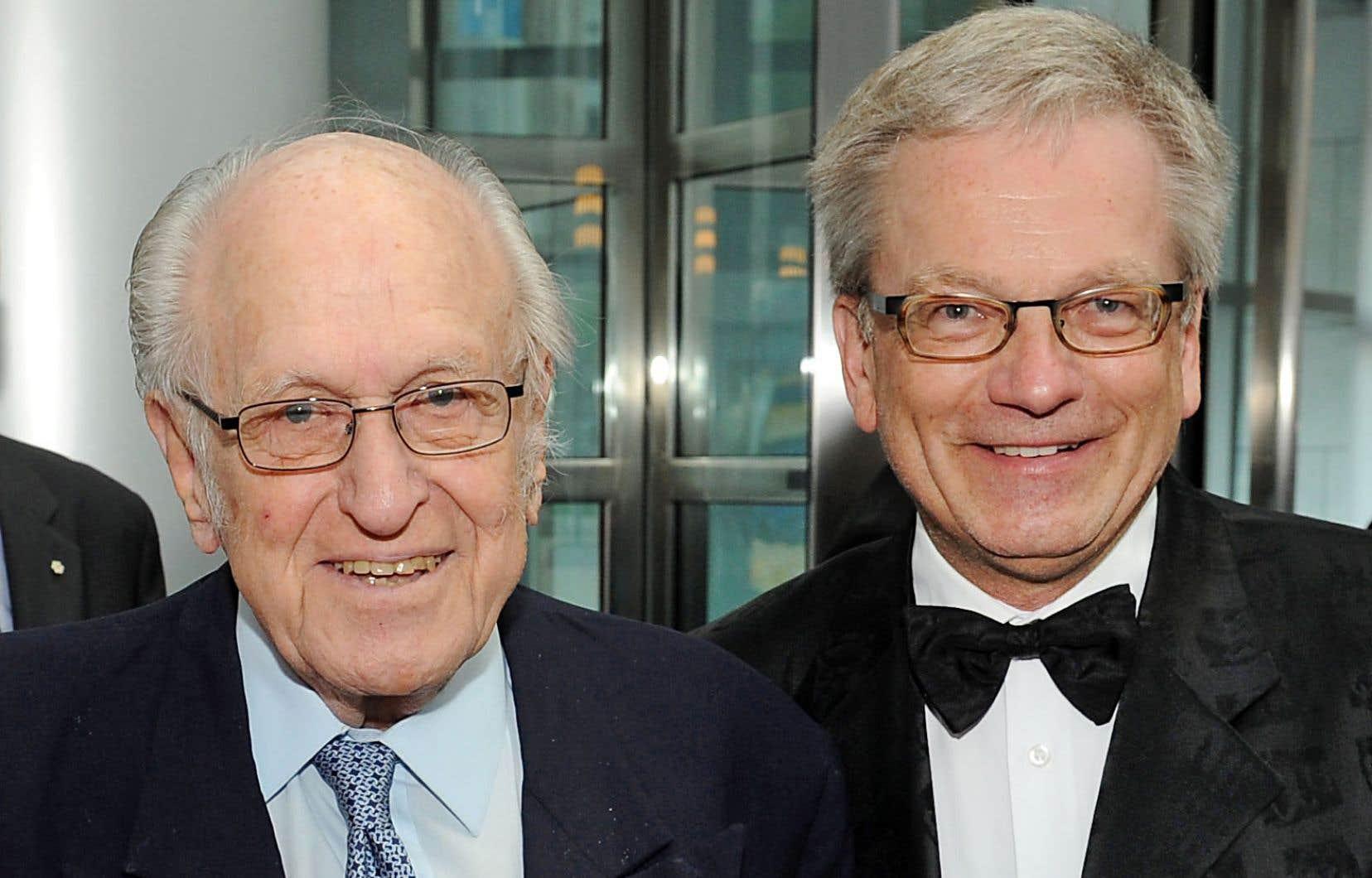 Le DrJacques Genest (à gauche), en 2014, avec le professeur Rémi Quirion, scientifique en chef du Québec, lors du banquet au Musée des beaux-arts où fut célébré le 50eanniversaire du FRQS.