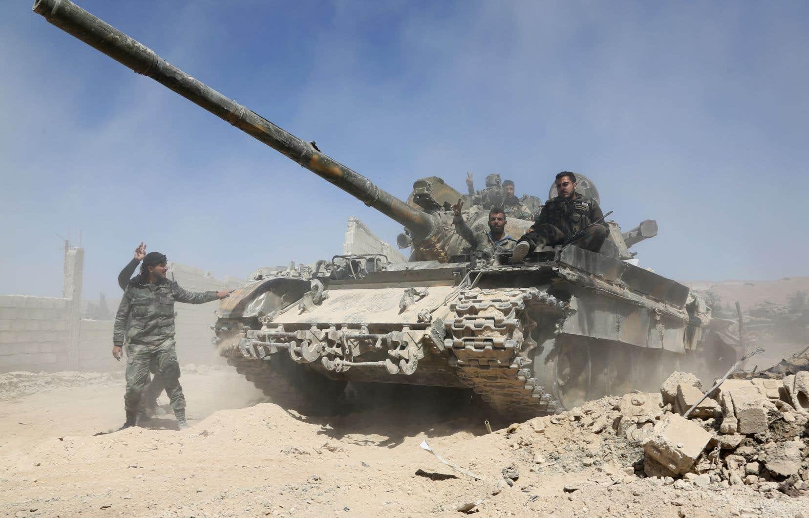 Les forces du régime syrien avancent vers la ville de Douma, la dernière zone de l'opposition dans la Ghouta orientale, samedi.