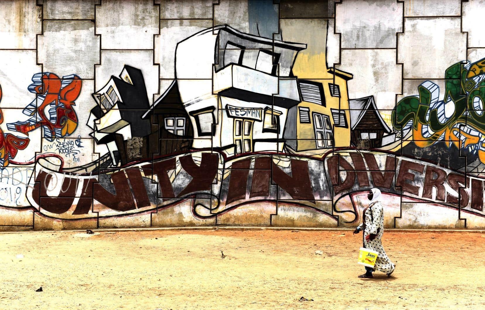Une peinture murale à Dakar. Le Sénégal cultive avec fierté son modèle de tolérance depuis son indépendance, acquise en 1960.