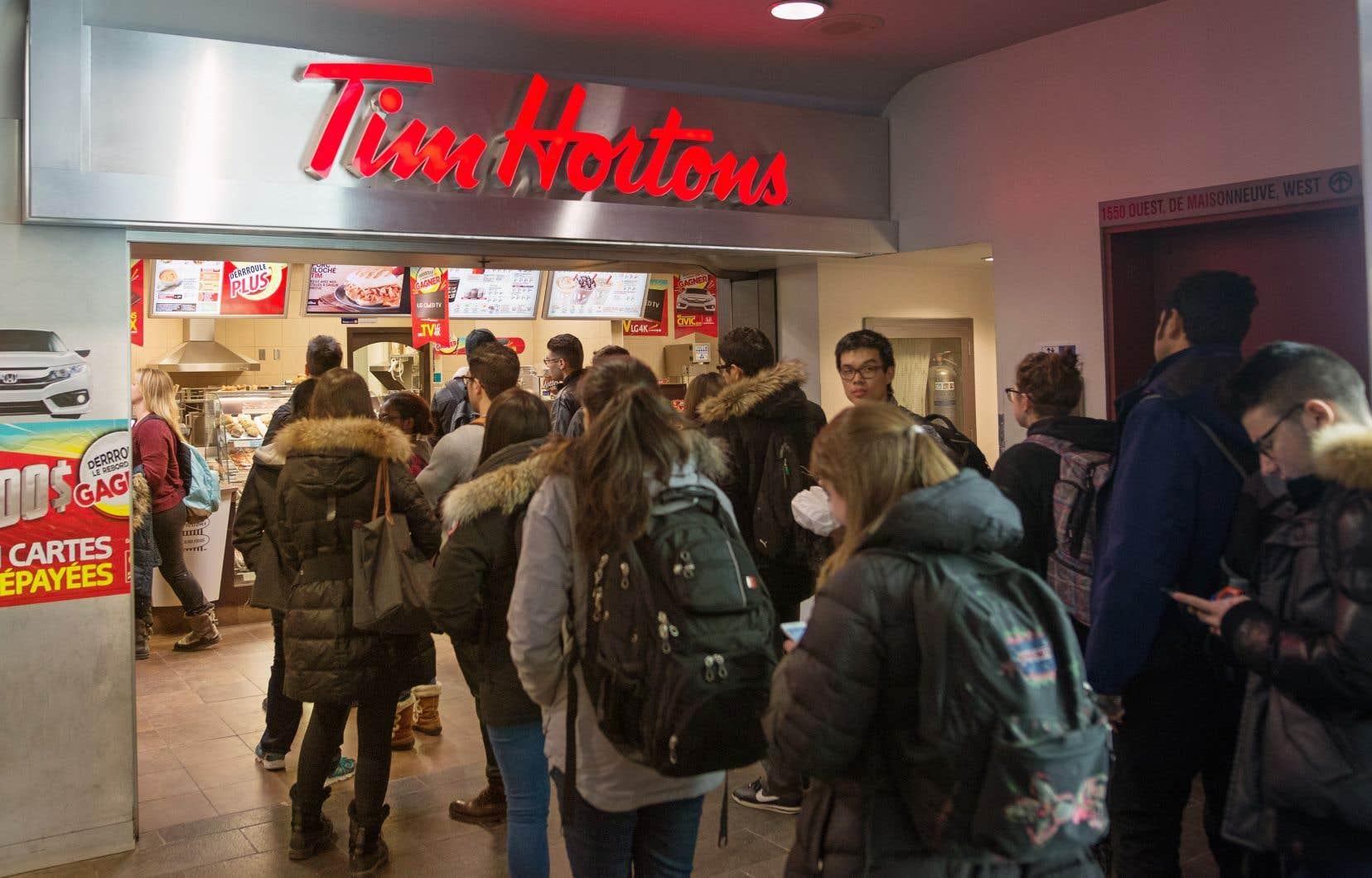 Un groupe de franchisés mécontentsa dénoncé la société mère de Tim Hortons pour certaines mesures qui, selon elle, ont miné leurs activités.
