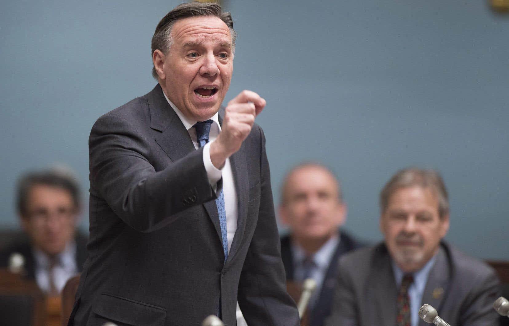 Le premier ministre a accusé mercredi le parti de François Legault de proposer «une droite dure».