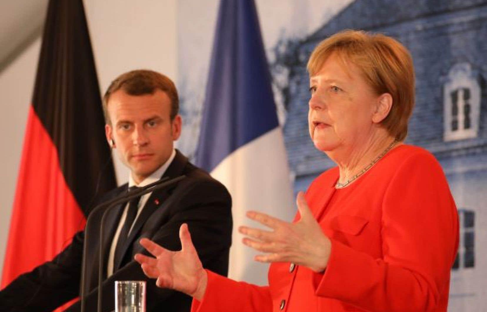 Emmanuel Macron et Angela Merkel ont annoncé mardi travailler à un accord visant à refouler tout demandeur d'asile en Europe vers l'État où il a été enregistré en premier.