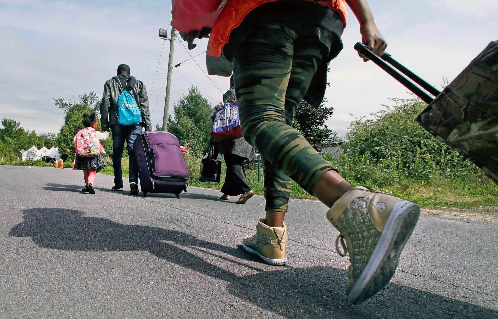 Le ministre Hussen s'est montré particulièrement agacé par l'attitude de l'Ontario quant à la situation des migrants.