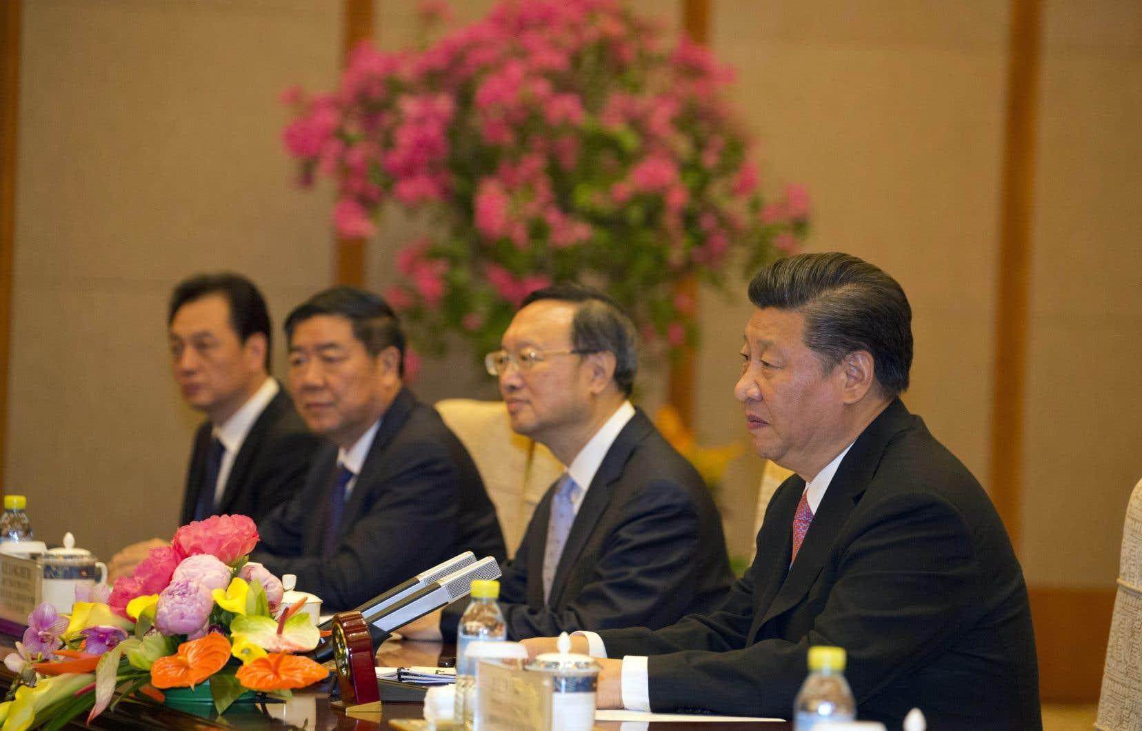 Le président chinois, Xi Jinping (à droite)