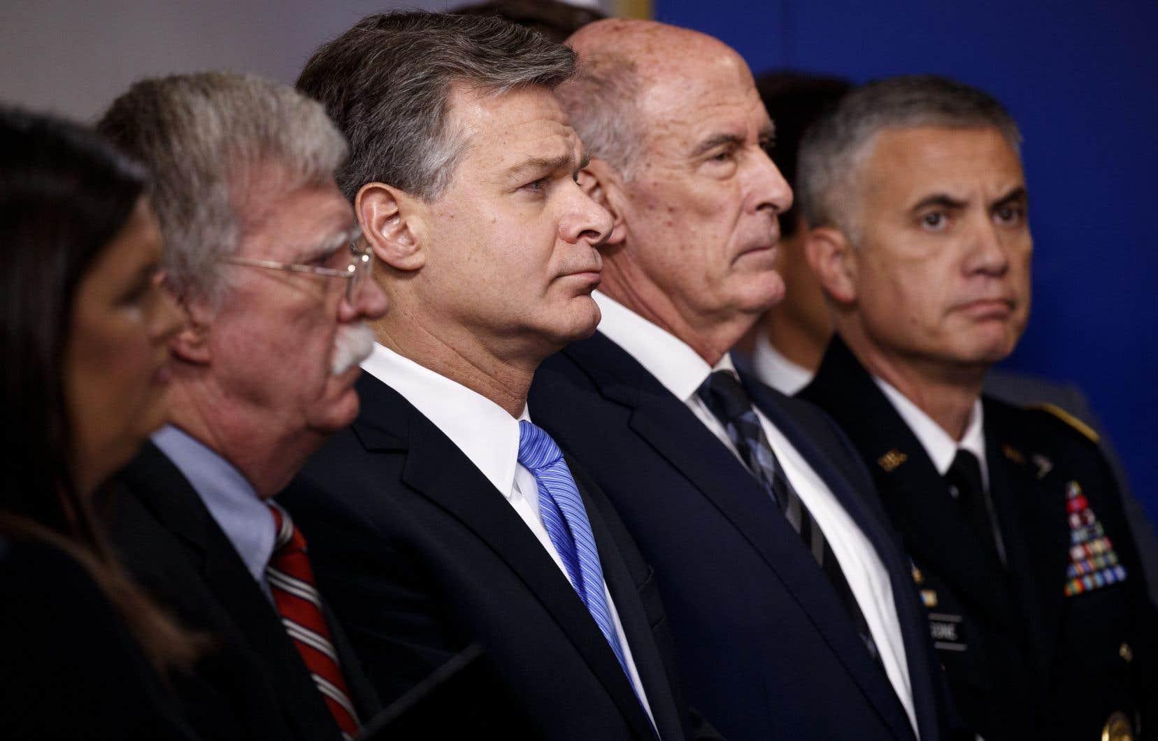 «C'est une menace que nous devons prendre très au sérieux», a mis en garde Christopher Wray, le patron du FBI (au centre de la photo).