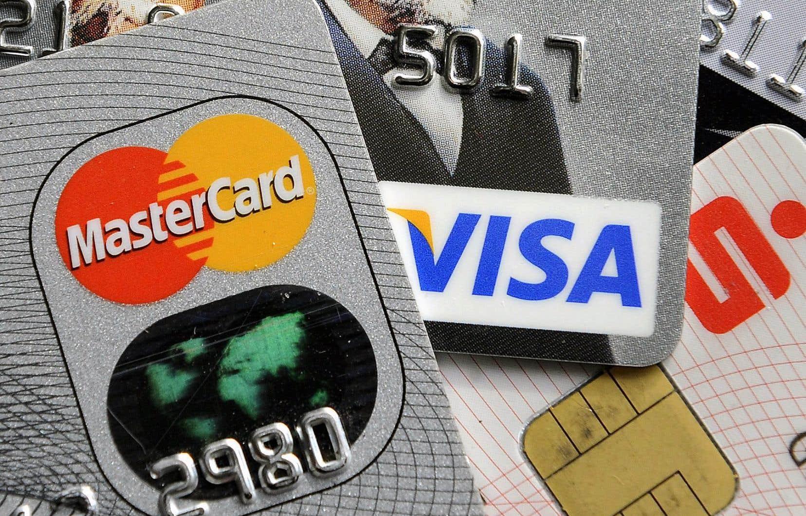 Ottawa a conclu des ententes volontaires de cinq ans avec Visa, MasterCard et American Express.
