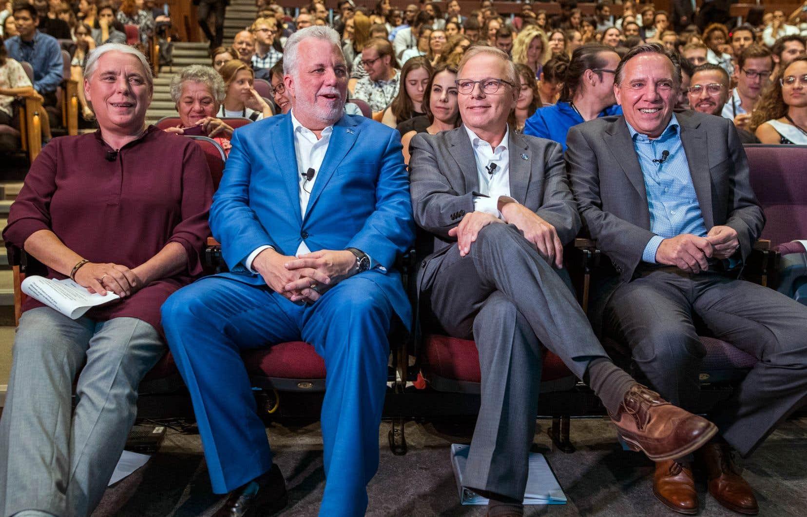 Manon Massé, Philippe Couillard, Jean-François Lisée et François Legault ont participé vendredi à une soirée politique consacrée à la génération des 18-35 ans, organisée par l'Institut du Nouveau Monde et «Le Devoir».