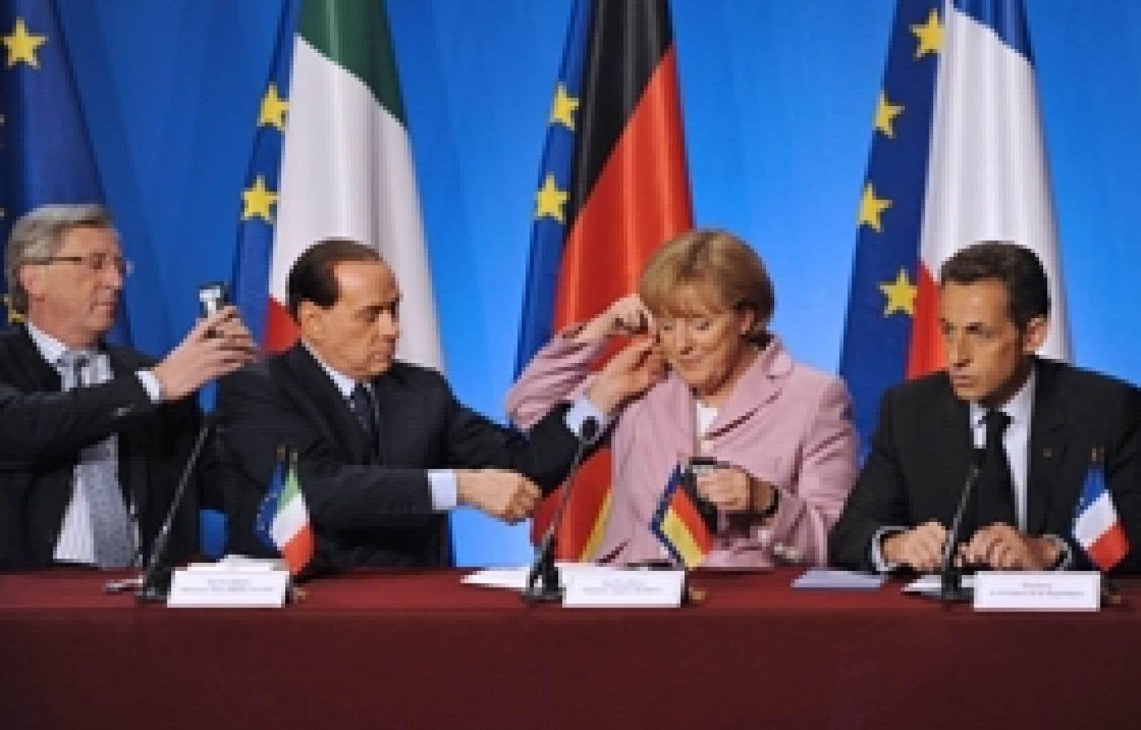 Le premier ministre du Luxembourg, Jean-Claude Dunker, son homologue italien, Silvio Berlusconi, la chancelière allemande, Angela Merkel, et le président français, Nicolas Sarkozy, ont travaillé de concert, samedi, pour tenter de trouver une solution
