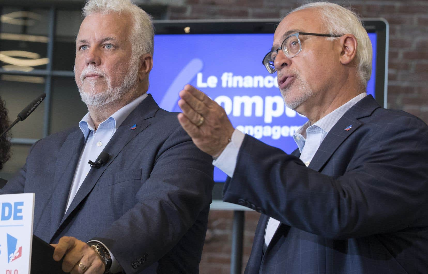 Le chef du Parti libéral du Québec, Philippe Couillard, etson ministre des Finances, Carlos Leitão