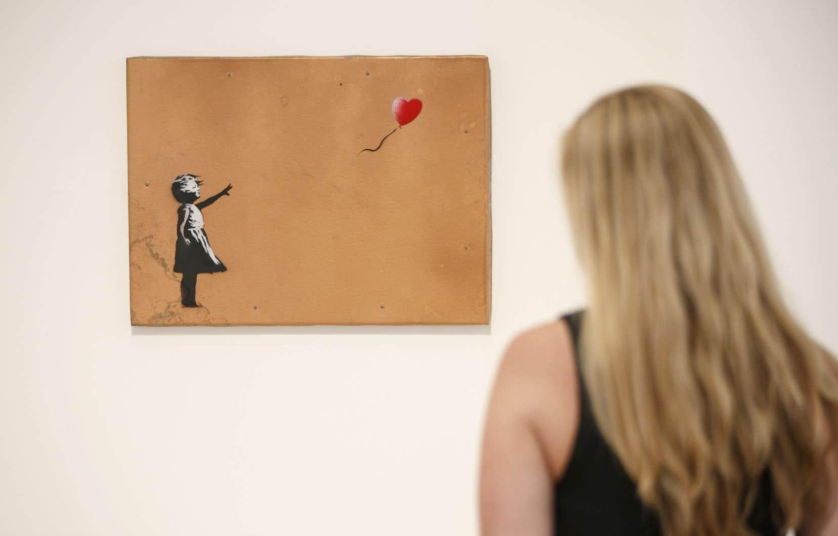 L'oeuvre de Banksy «Girl with Balloon» exposée à la Lazinc Gallery de Londres le 11 juillet 2018