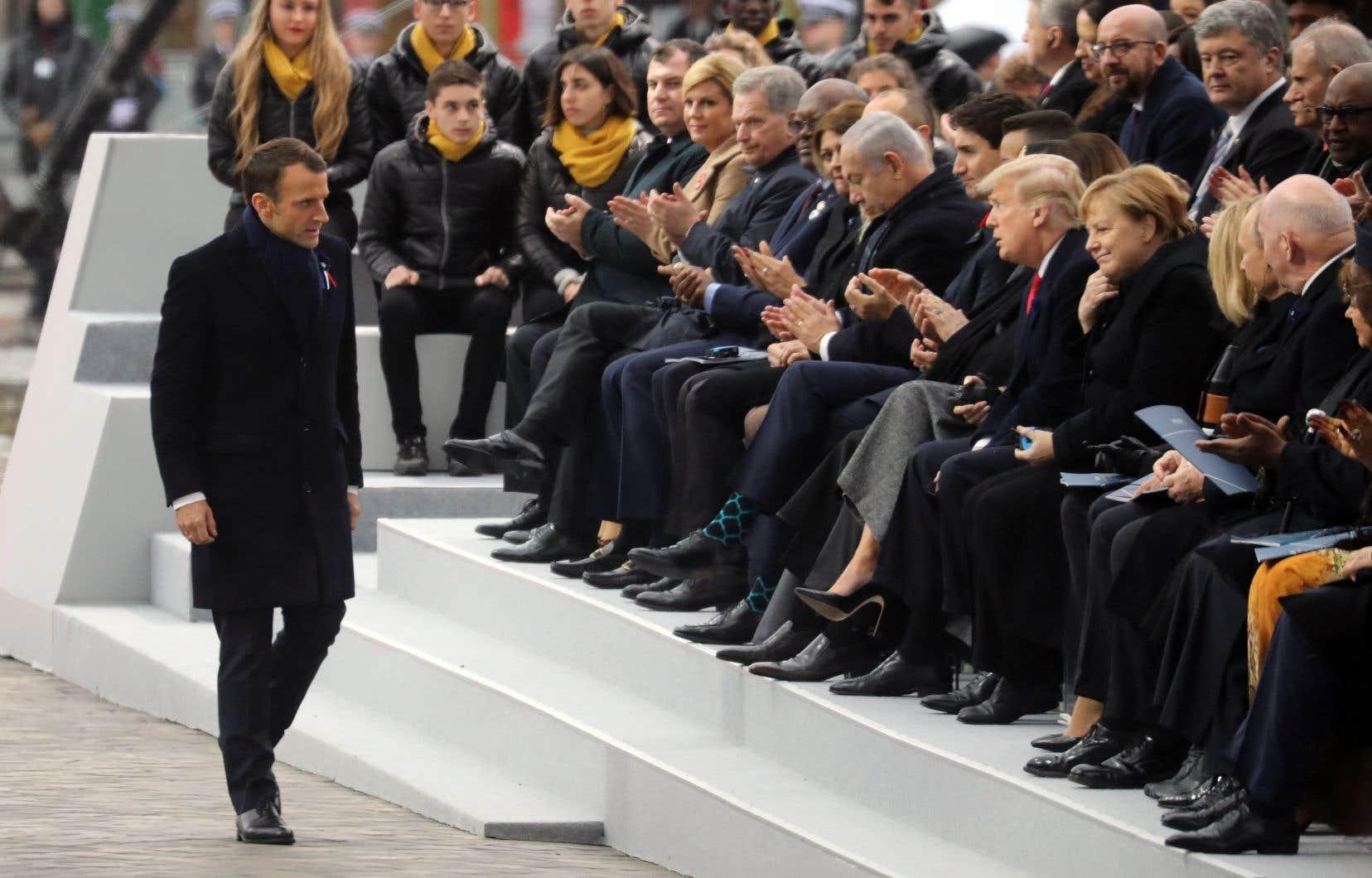 Le président français, Emmanuel Macron, en compagnie des dirigeants mondiaux lors d'une cérémonie à l'Arc de Triomphe à Paris dans le cadre des commémorations du centième anniversaire de l'armistice du 11 novembre 1918, mettant fin à la Première Guerre mondiale.