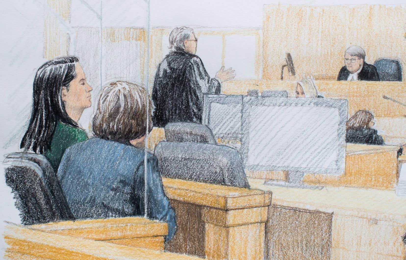 La directrice financière de l'entreprise chinoise Huawei, Meng Wanzhou, dessinée avec ses avocats lors d'une audience devant les tribunaux de la Colombie-Britannique
