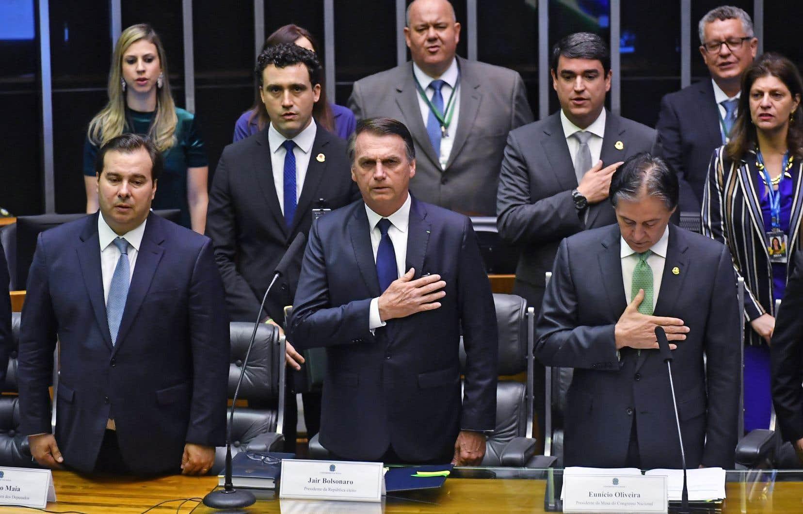 Jair Bolsonaro (à l'avant), au Congrès, avant de prendre la tête du Brésil. Le nouveau président veut radicalement rompre avec l'ordre établi.