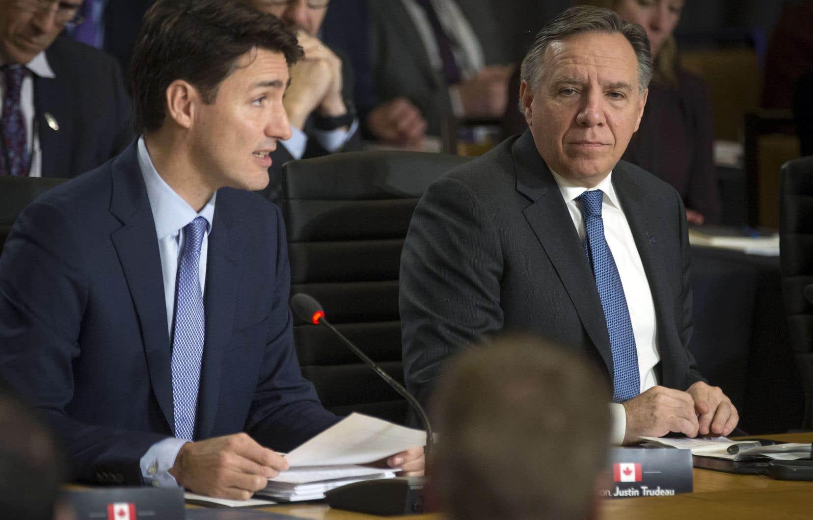 Les premiers ministres canadien, Justin Trudeau, et québécois, François Legault, lors de la conférence des leaders du pays à Montréal, en décembre 2018