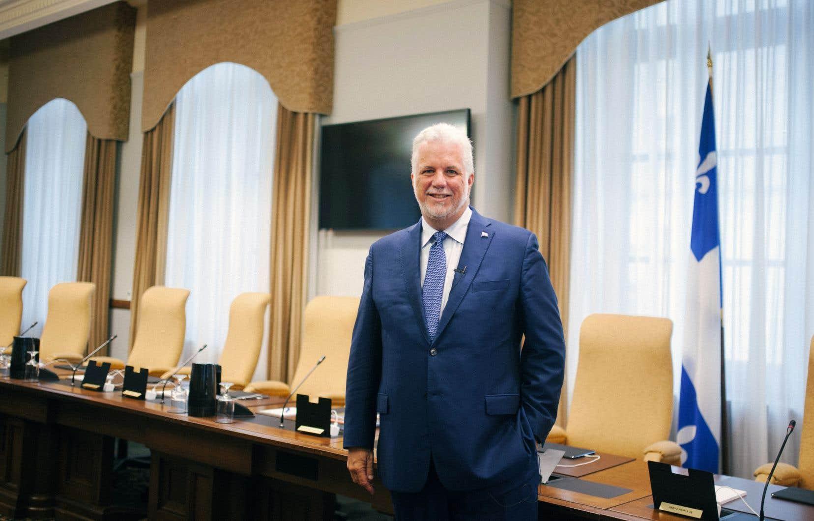 L'ex-premier ministre Philippe Couillard alors qu'il était en fonction, dans son bureau de l'édifice Honoré-Mercier en août dernier