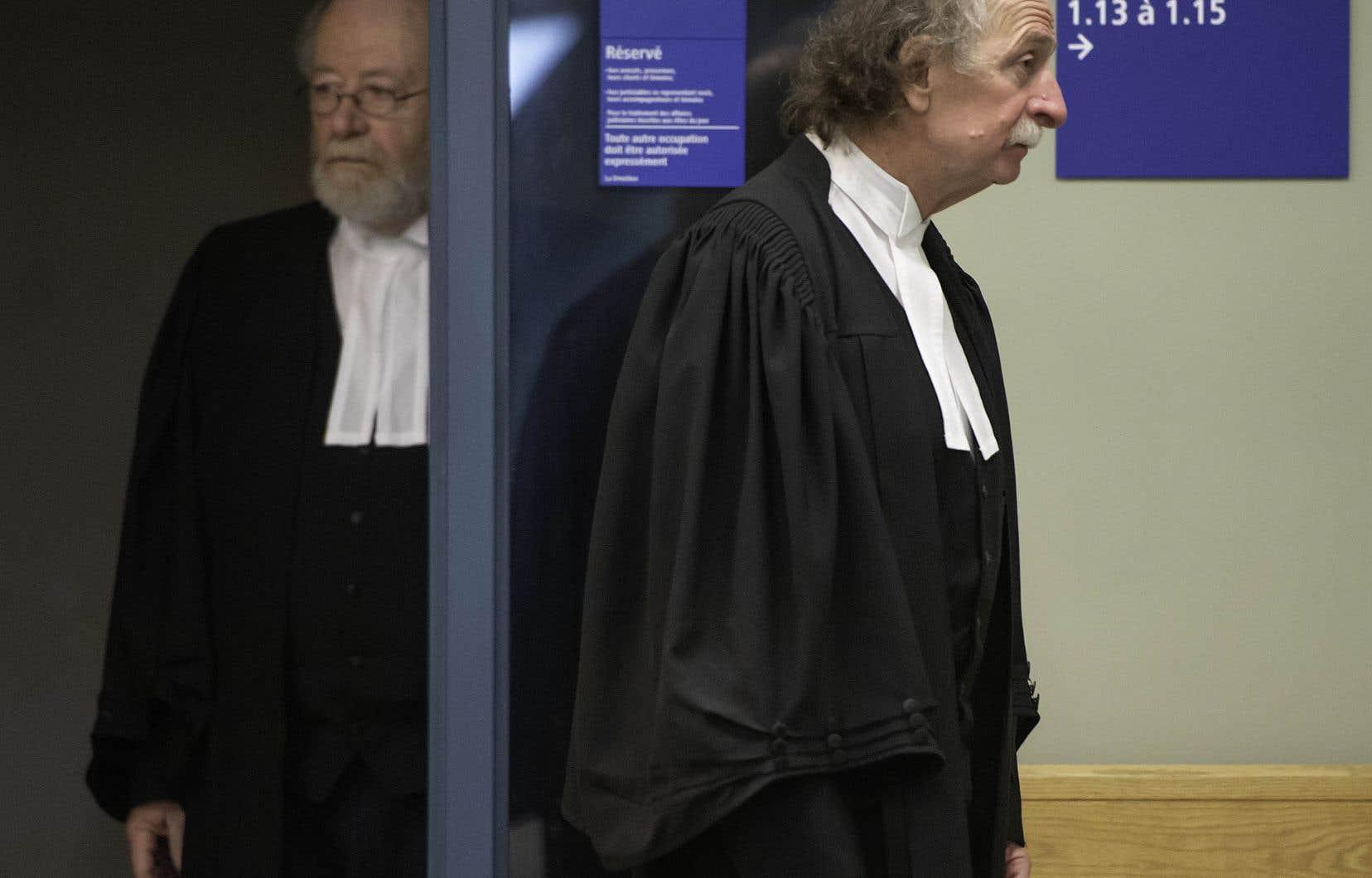Les avocats d'Adèle Sorella, Pierre Poupart et Guy Poupart, à leur sortie d'une salle du palais de justice de Laval