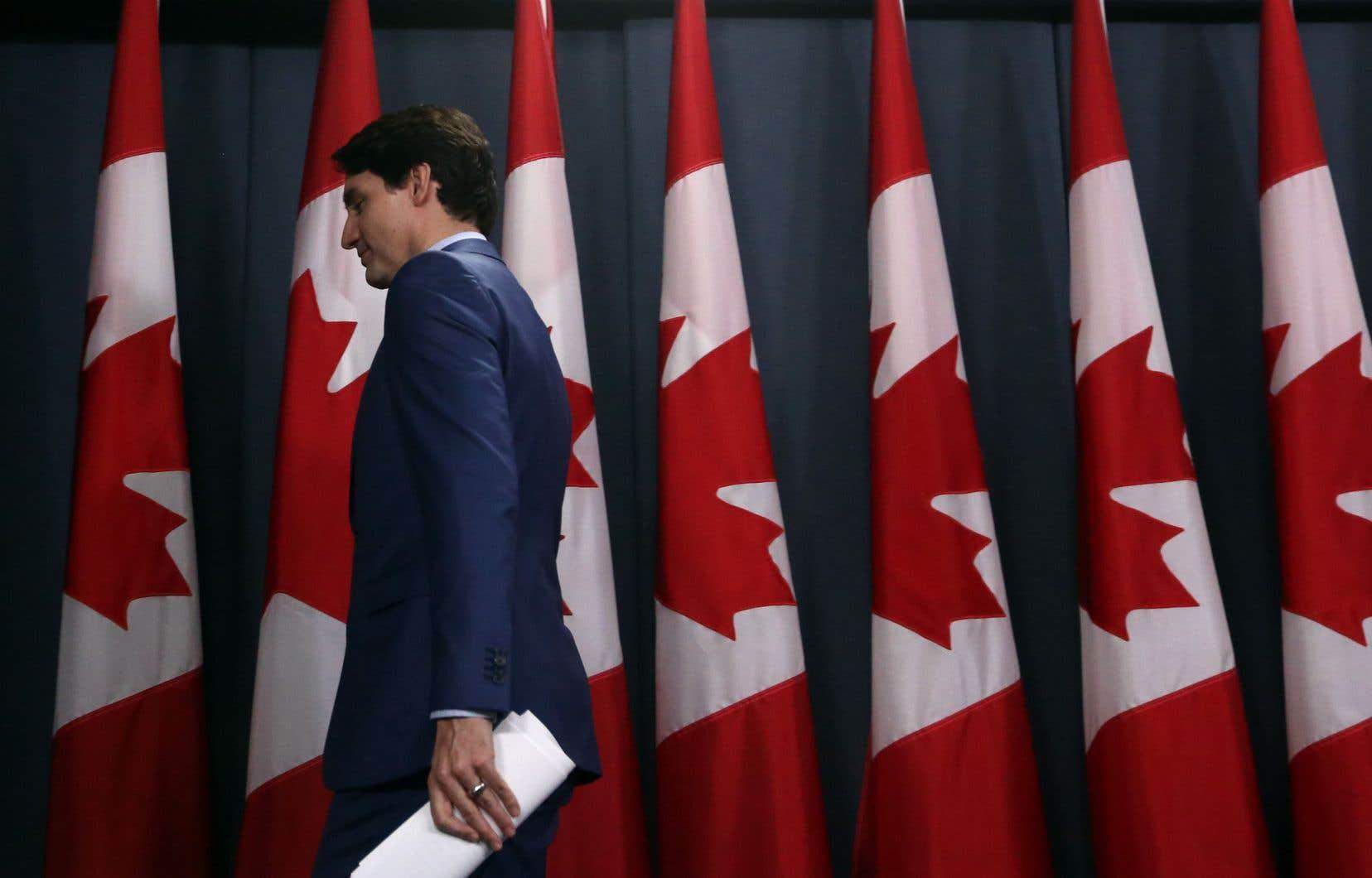 Le premier ministre Justin Trudeau quittant une conférence de presse qu'il a donnée jeudi à Ottawa pour répliquer à toute l'affaire entourant SNC-Lavalin qui secoue son gouvernement.