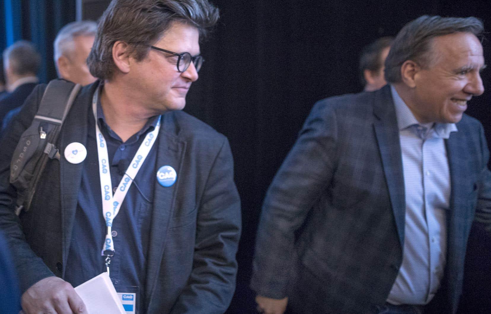 L'instigateur du Pacte pour la transition, Dominic Champagne, et le premier ministre François Legault