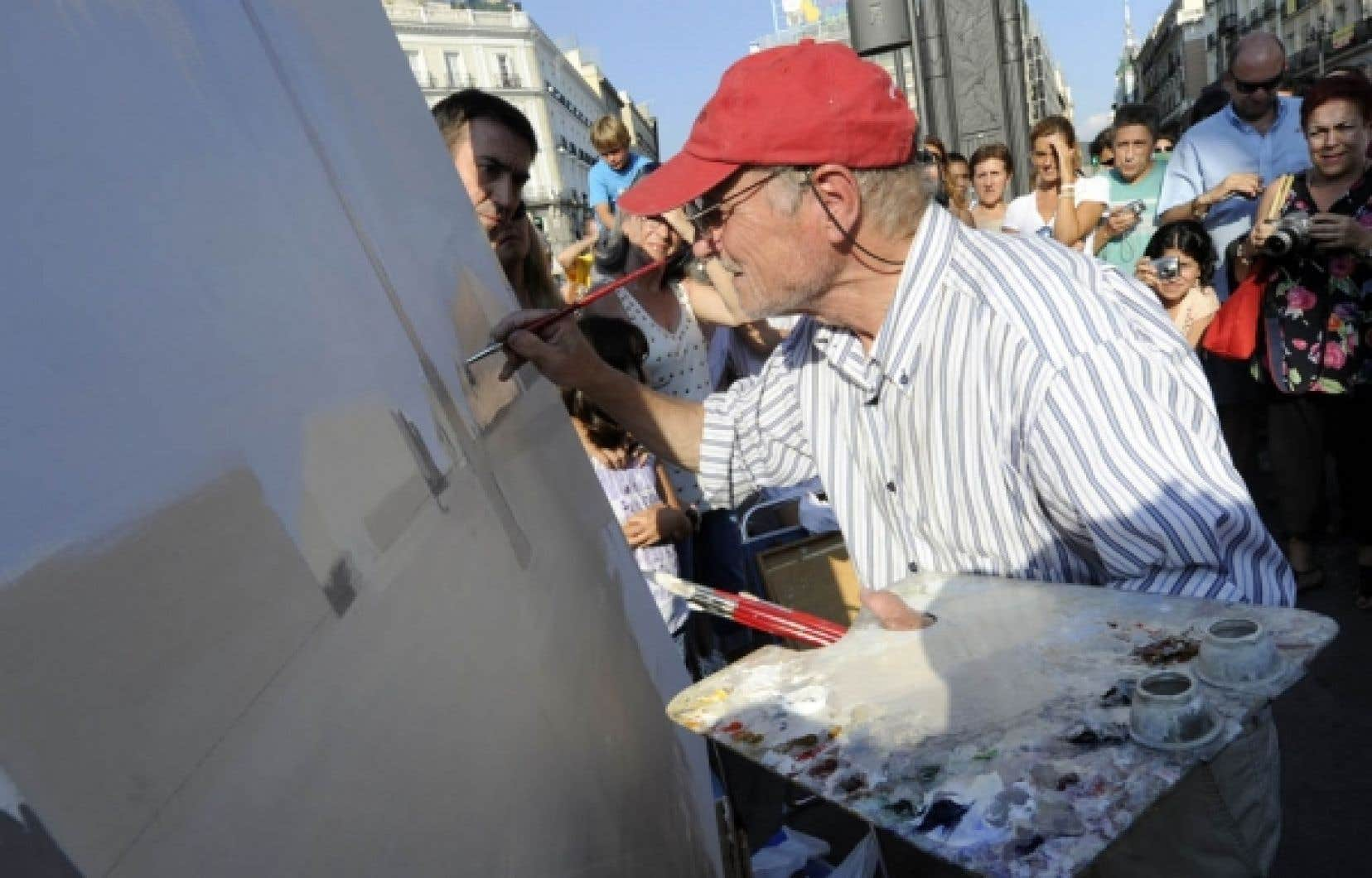 Le peintre antonio lopez montre son art sur la puerta del sol madrid le devoir - Autoescuela gala puerta del sol ...