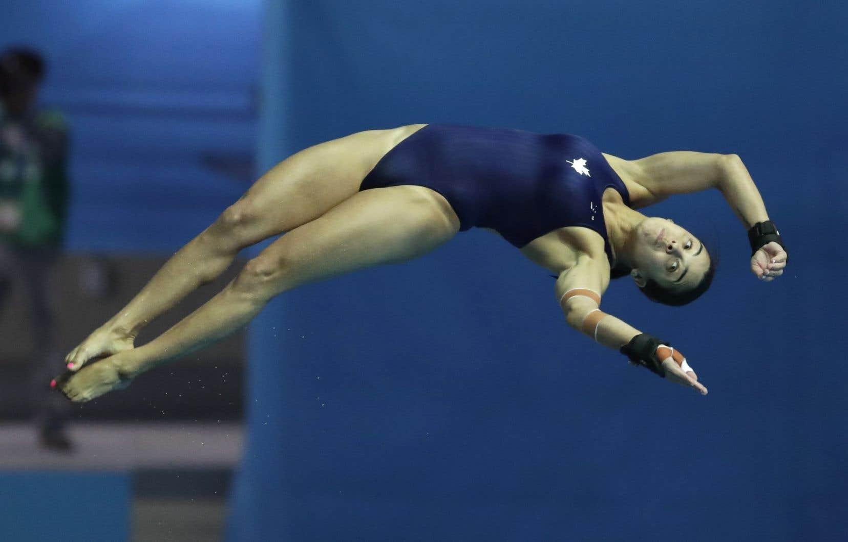 La MontréalaiseMeaghan Benfeito a terminé au quatrième rangparmi les 18 plongeuses inscrites àl'épreuve individuelle à la tour de 10 mètres, aux Championnats du monde de natation de Gwangju, en Corée du Sud.