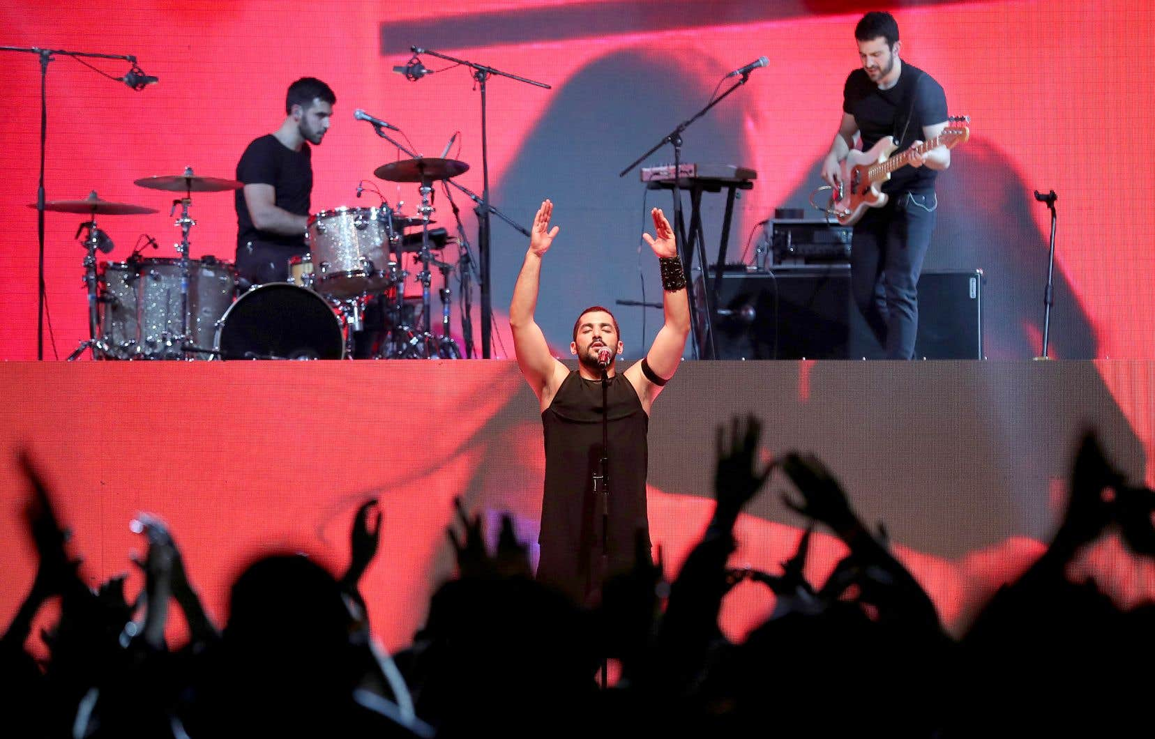 Ouvertement homosexuel, le chanteur Hamed Sinno (au centre) a propulsé Mashrou'Leila en porte-drapeau de la cause LGBT dans le monde arabe.