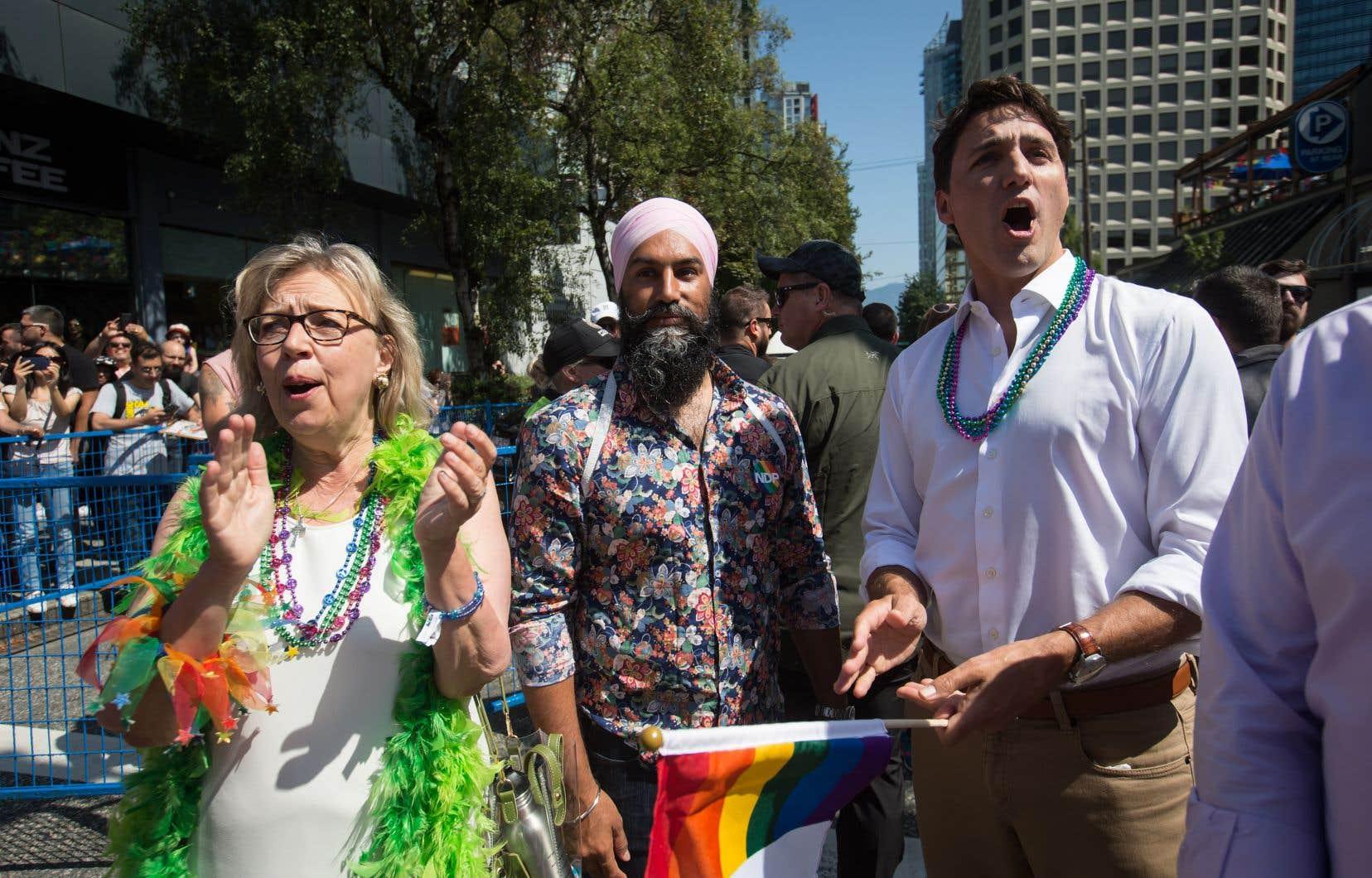 La chef du Parti vert, Elizabeth May, le chef néodémocrate Jagmeet Sing et le premier ministre Justin Trudeau