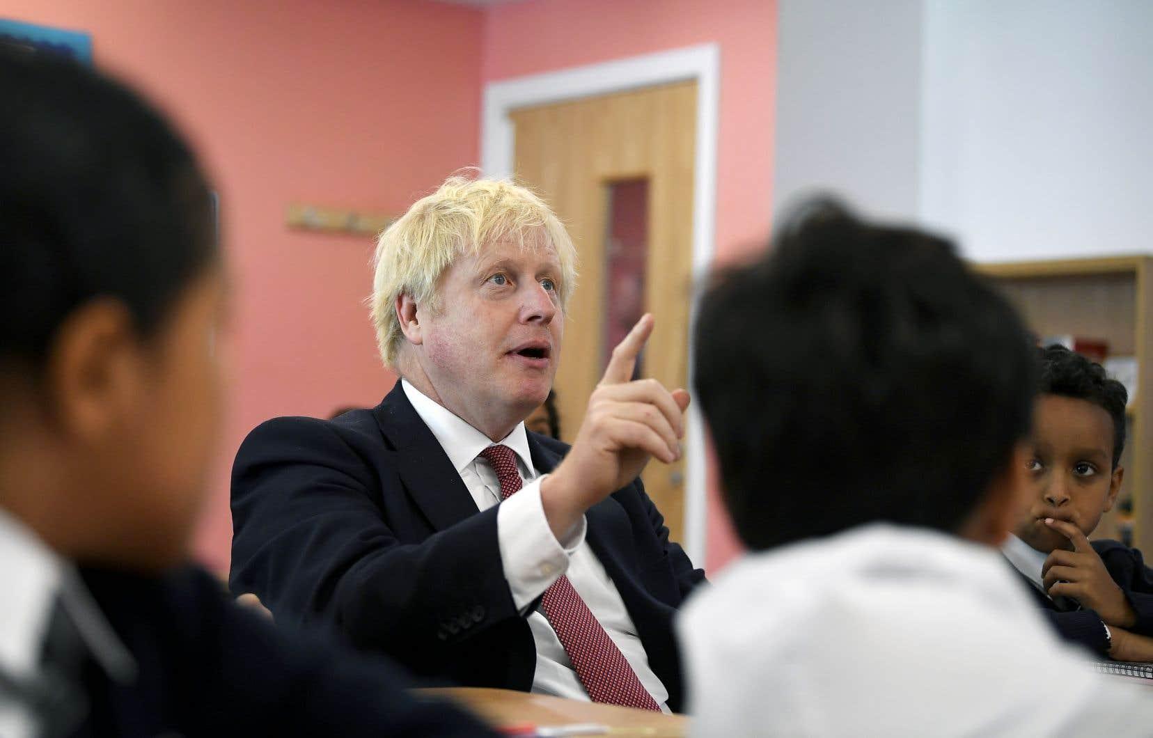 De passage dans une école londonienne, le premier ministre Boris Johnson a déclaré qu'il va «s'évertuer à obtenir un accord» d'ici au sommet européen.