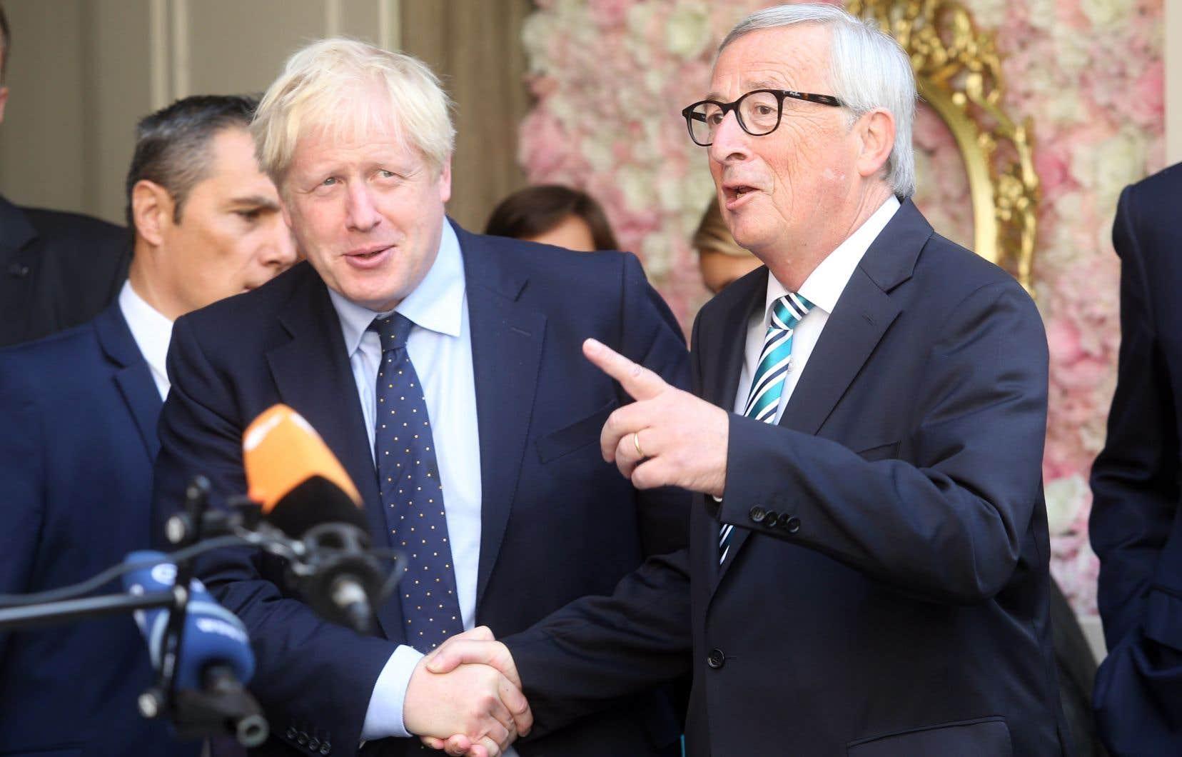 Le premier ministre britannique, Boris Johnson, etle président de la Commission européenne, Jean-Claude Juncker.