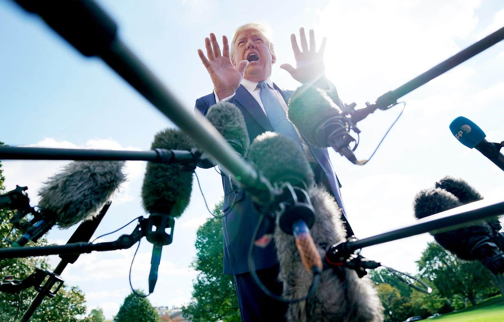 Vendredi, le président Donald Trump s'est longuement expliqué devant les médias réunis dans les jardins de la Maison-Blanche.
