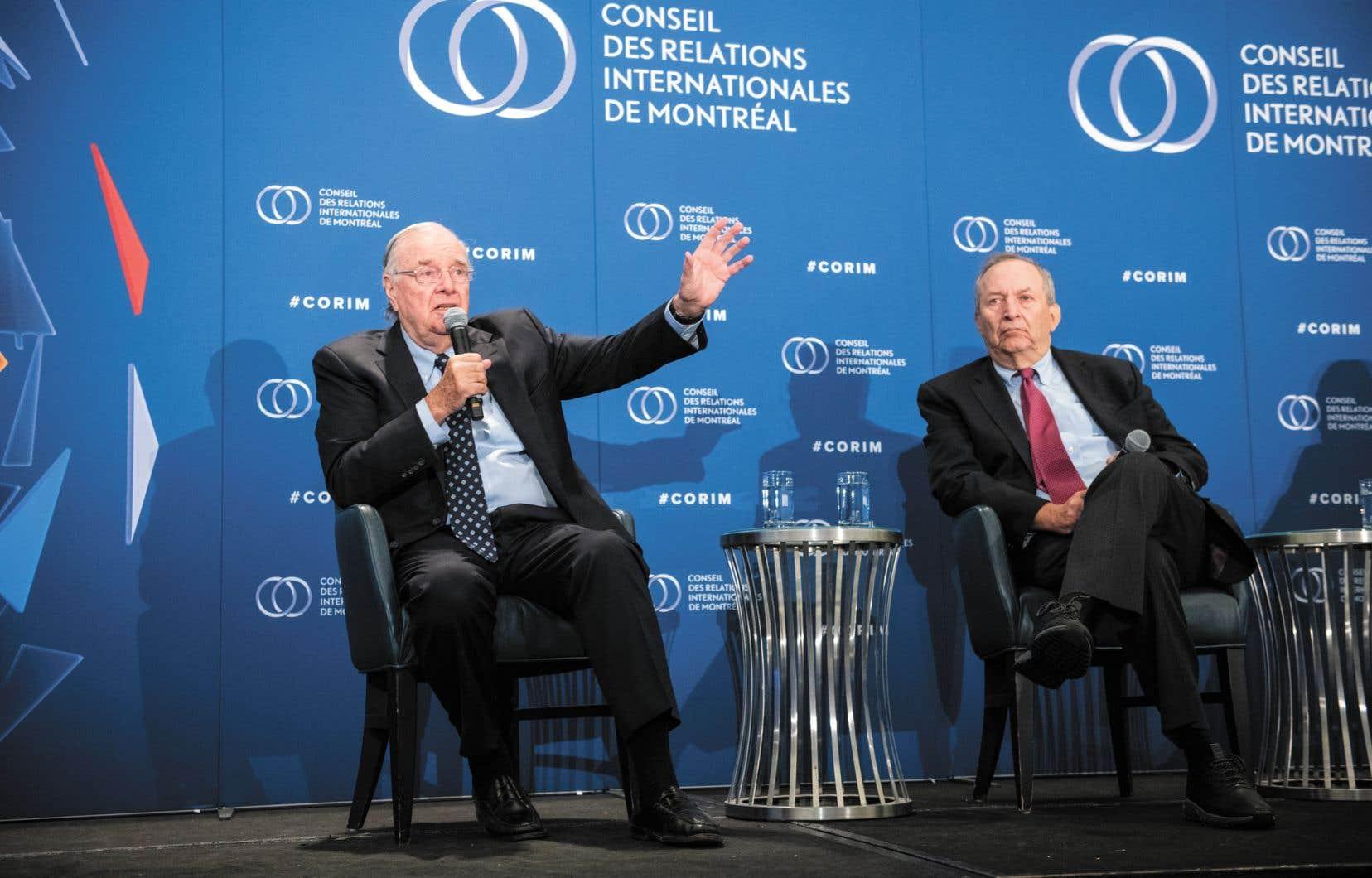 L'ex-premier ministre du Canada Paul Martin (à gauche) et l'ancien secrétaire au Trésor américain Larry Summers, qui ont fondé le G20 en 1999, ont partagé la scène du Conseil des relations internationales de Montréal mercredi.