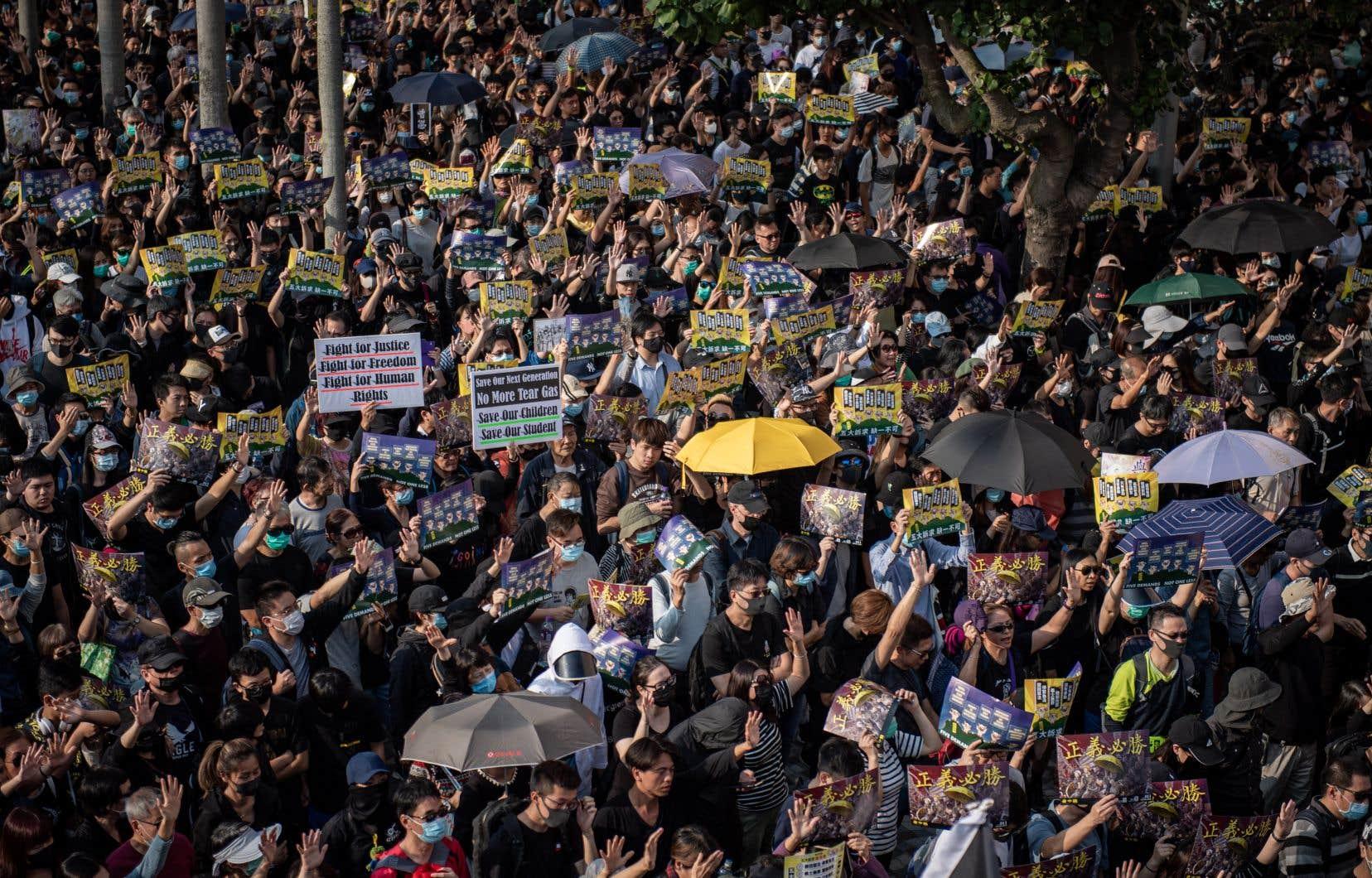 Les Hongkongais qui prenaient part à l'un des trois rassemblements autorisés dimanche par les autorités.