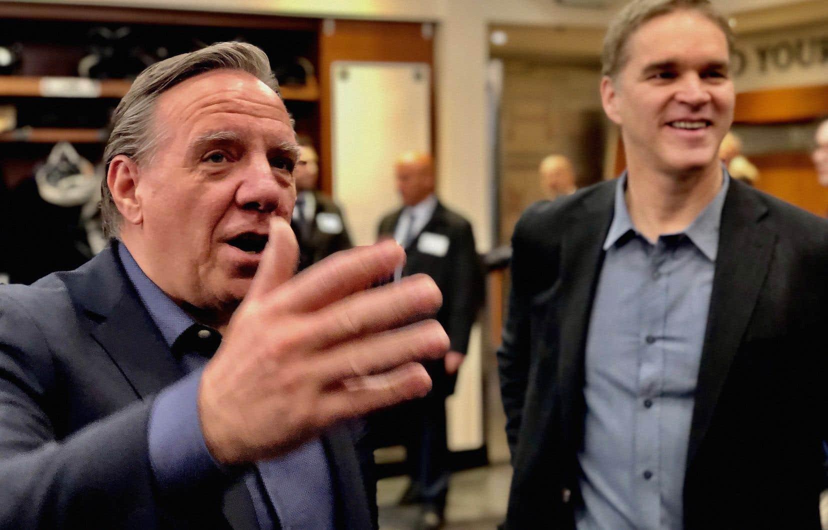 Le premier ministre québécois a amorcé sa mission économique hier en visitant le Staples Center en compagnie du président du club de hockey des Kings, Luc Robitaille.