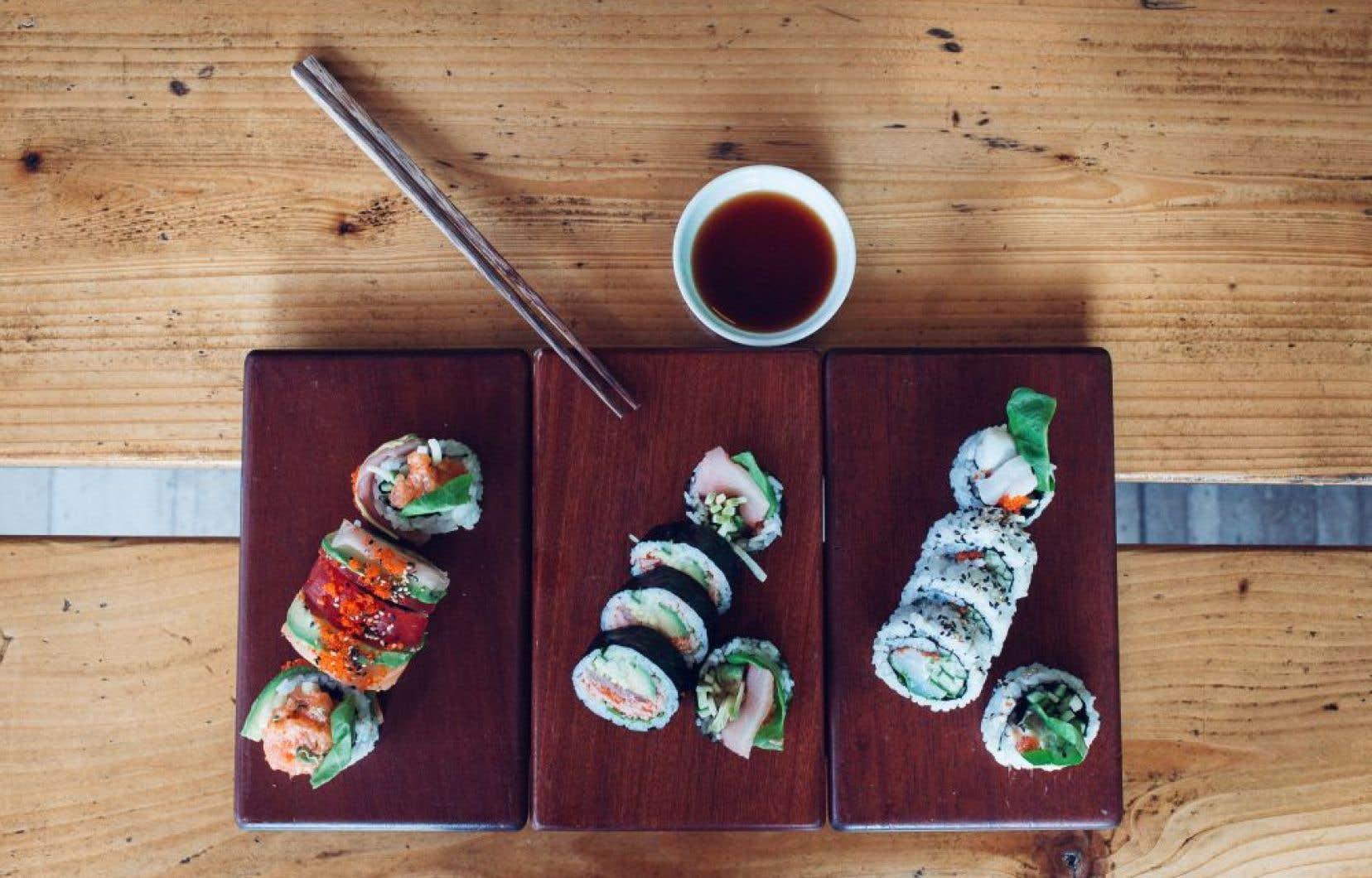 De gauche à droite: le «Petite Patrie»: thon, saumon et hamachi; le «Beaubien»: homard, thon et hamachi; et le sushi pétoncle épicé.