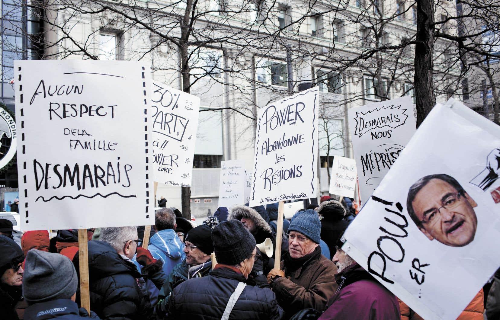 Les retraités de Groupe Capitales Médias reprochent à Power Corporation d'avoir échappé à ses obligations envers eux lors de la vente des six journaux régionaux à l'ex-ministre libéral Martin Cauchon en 2015. Ils ont manifesté devant le siège social montréalais de l'entreprise, le mercredi 11 décembre.