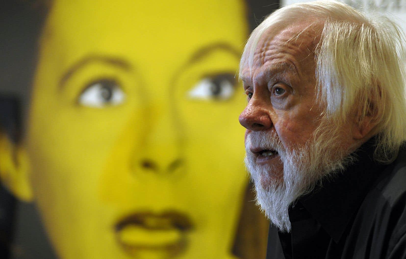 Peintre reconverti dans l'art conceptuel, et notamment adepte des collages et des détournements de photos, il avait construit sa carrière en dehors des sentiers battus. Sur notre photo: l'artiste devant son œuvre intitulée «Prima Facie (Third state): From Aghast to Upset», en 2010.