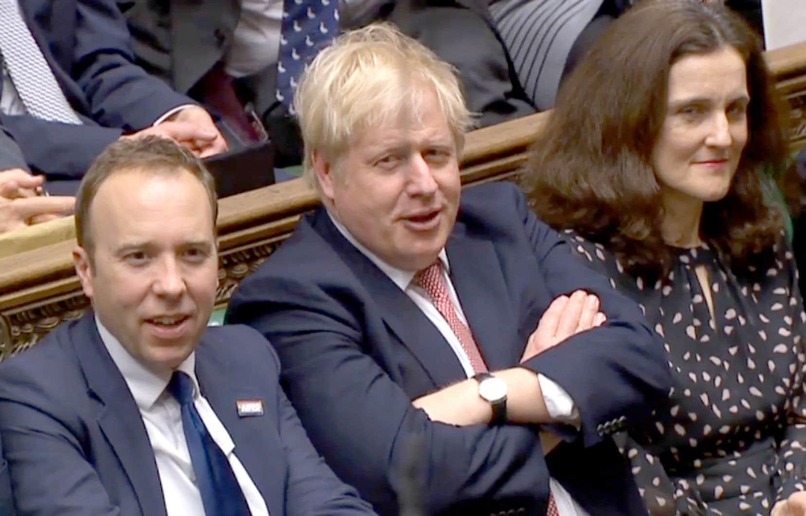 Le premier ministre britannique, Boris Johnson, affichait un air satisfait, jeudi, après le vote du Parlement sur le Brexit.