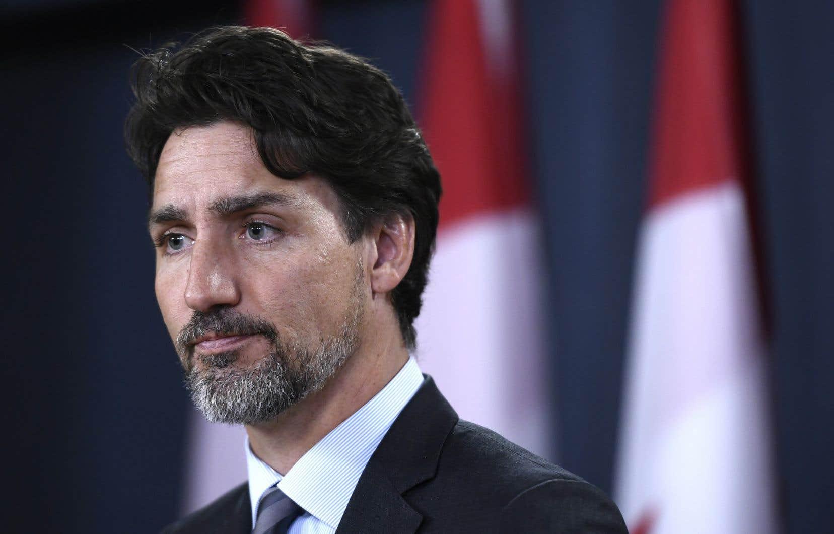 Lundi, M.Trudeau a admis que s'il n'y avait pas eu ces tensions dans la région, les Canadiens du vol PS752seraient chez eux, auprès de leurs familles.