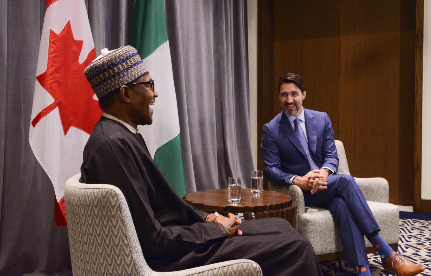 M.Trudeau a participé à un dîner en compagnie de femmes d'affaires éthiopiennes en plus d'enchaîner les face à face avec des leaders du Nigeria (sur la photo), de la Somalie, de la Mauritanie et de Madagascar.