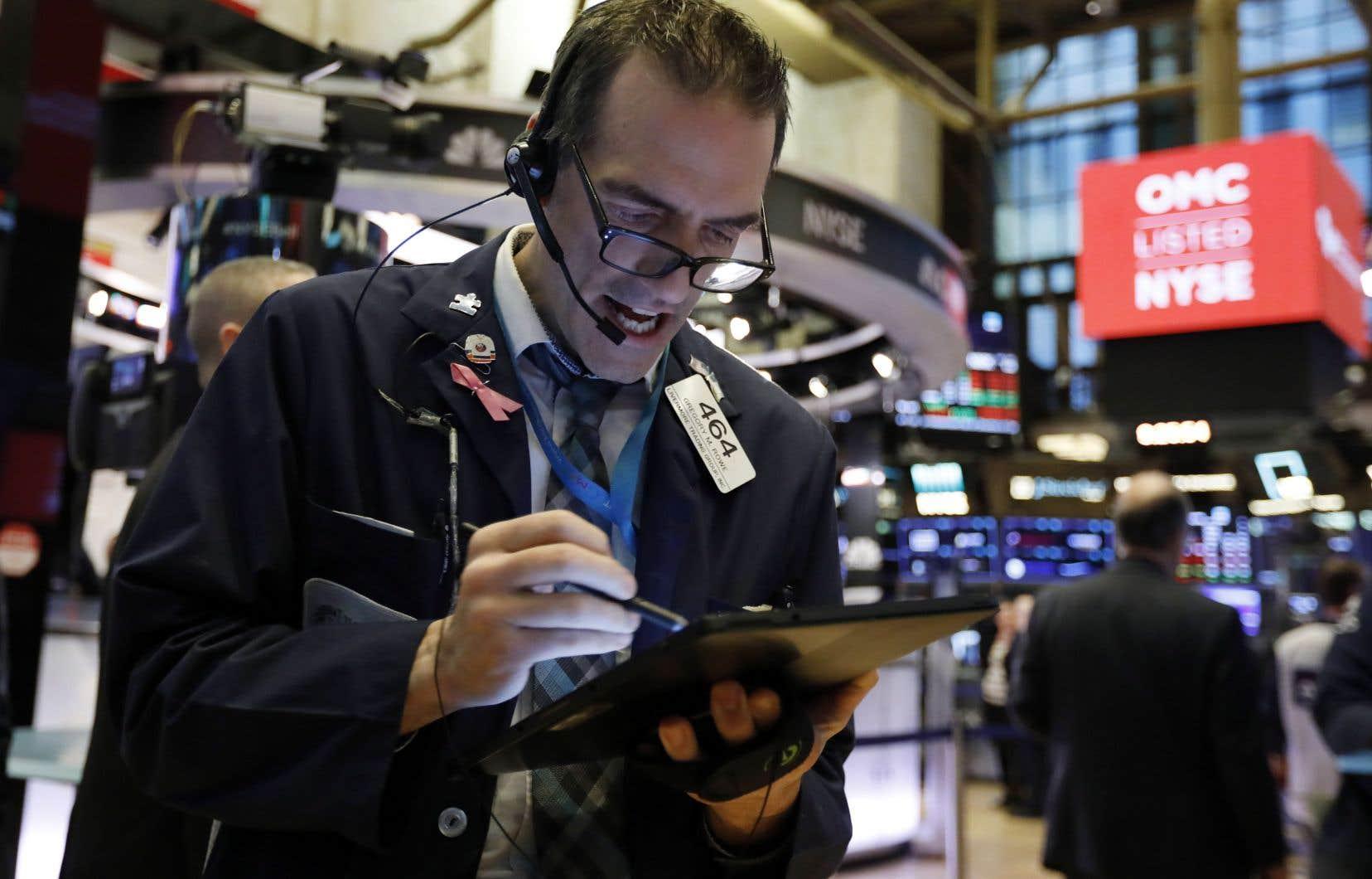 De l'Asie à l'Europe, en passant par Wall Street (photo) et Toronto, les investisseurs craignent les effets négatifs du virus sur une économie mondiale qui battait de l'aile même avant son apparition.