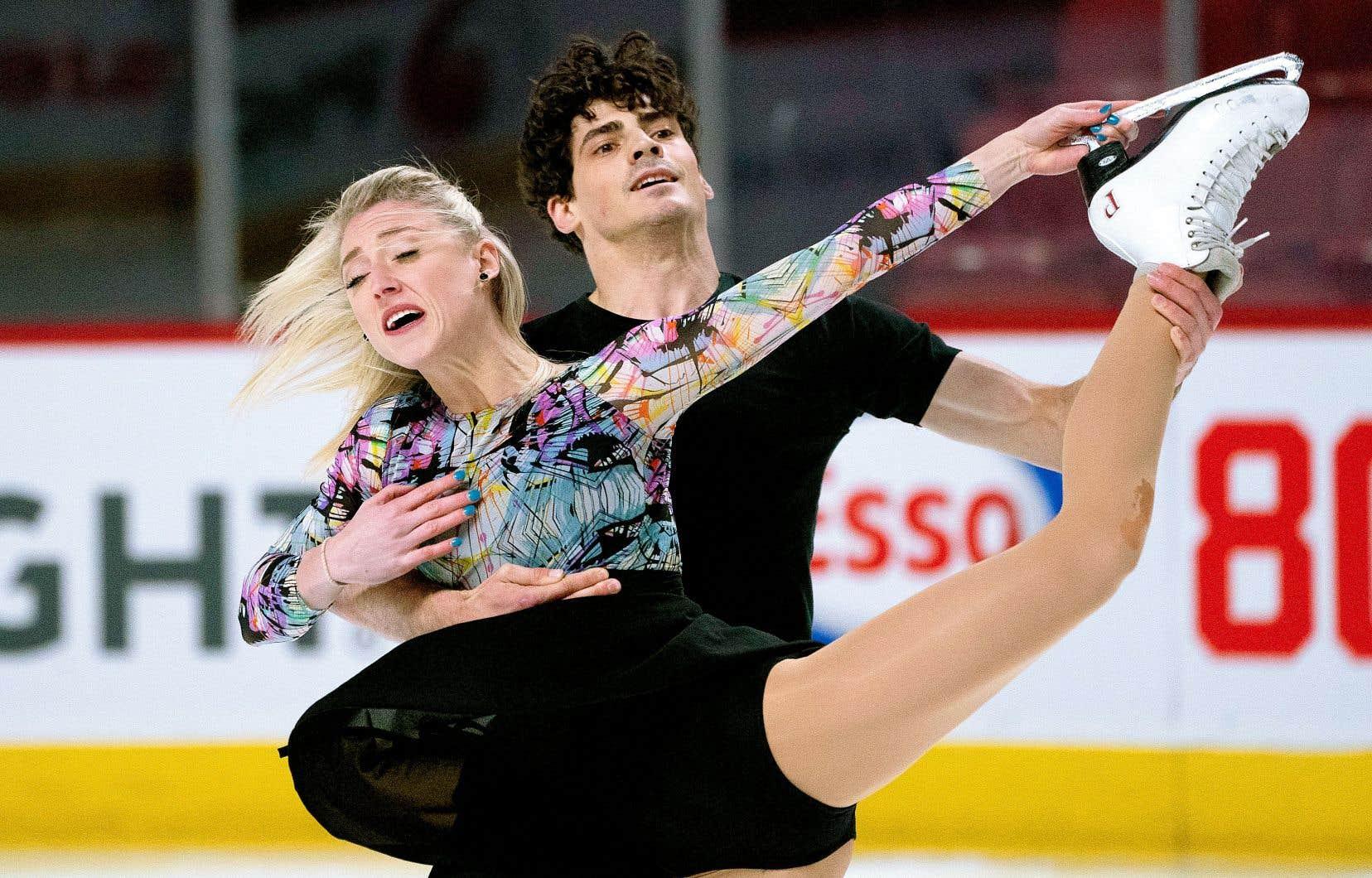 Le duo canadien formé de Piper Gilles et de Paul Poirier devait prendre part aux Mondiaux de patinage artistique, qui étaient prévus à Montréal du 16 au 22mars.