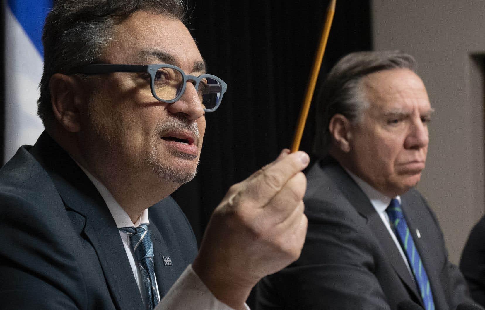 Le directeur de la santé publique du Québec, Horacio Arruda, et le premier ministre François Legault.
