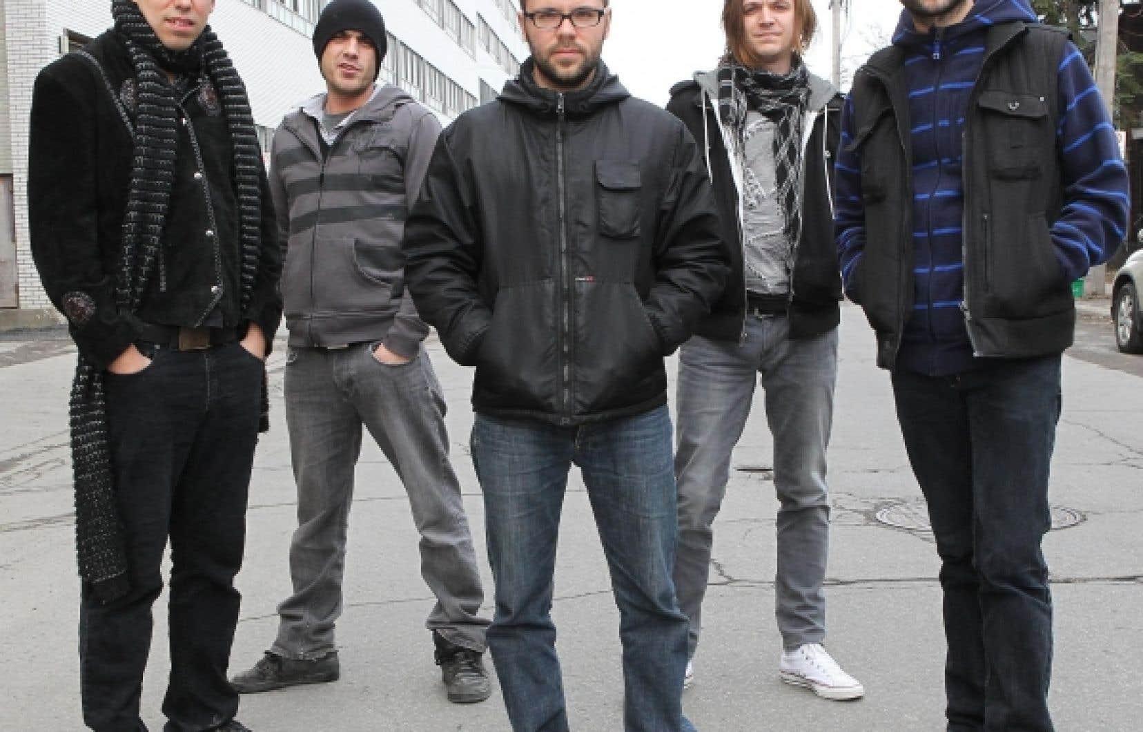 Karkwa, en mars 2010. Dans l'ordre habituel,Julien Sagot, Martin Lamontagne, Stéphane Bergeron, François Lafontaine et Louis-Jean Cormier.