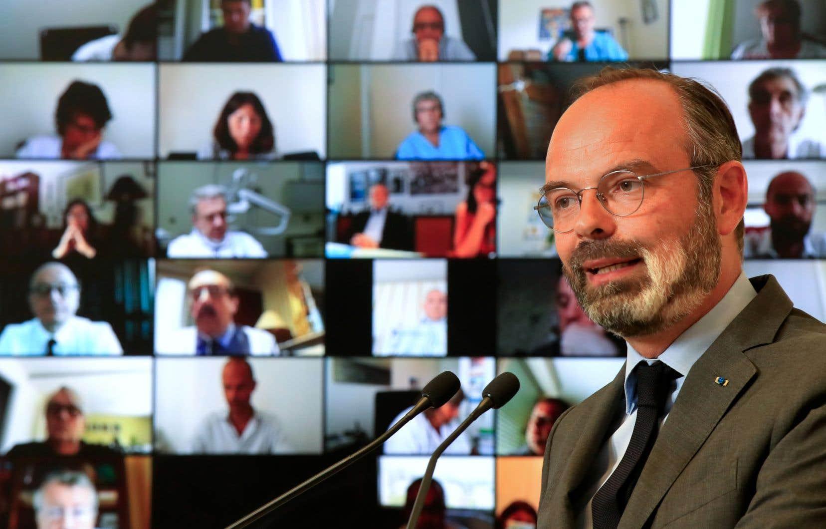 Le premier ministre français, Édouard Philippe, s'est exprimé lundi au cours d'une large visioconférence depuis le ministère de la Santé.