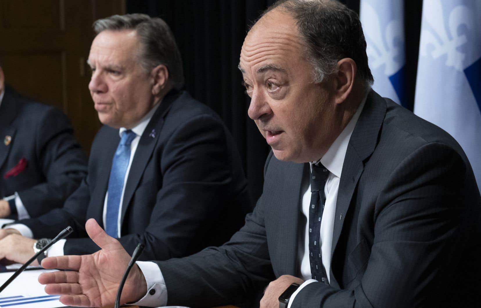 Le premier ministre du Québec, François Legault (à gauche sur la photo) et le président du Conseil du trésor, Christian Dubé